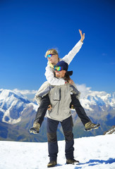 Happy couple on snow top. Sport and active life concept