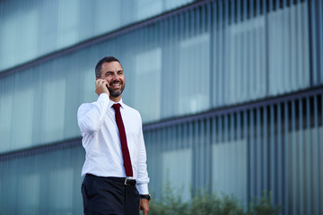 Businessman in a white shirt talking on the phone
