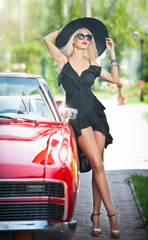 Summer portrait of stylish blonde vintage woman with long legs