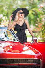 Outdoor summer portrait of stylish blonde vintage woman posing
