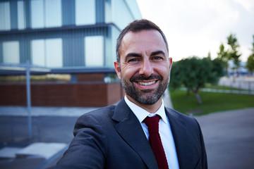 Businessman in a suit selfie