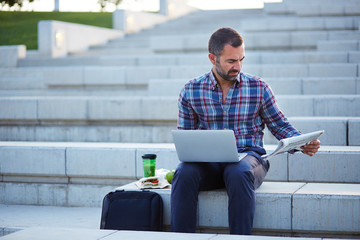 Modern businessman working outdoors