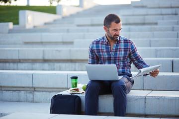 Modern businessman working outdoors