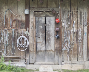Old shack with lots of tools, chains, ropes and pots