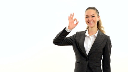 Charming woman showing copy space and showing okay.