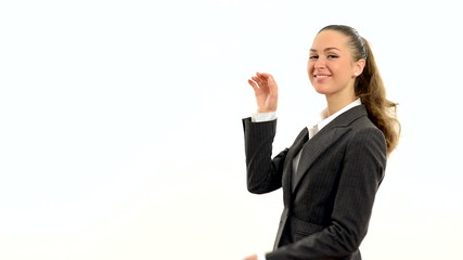 Charming woman showing copy space and showing thumb.