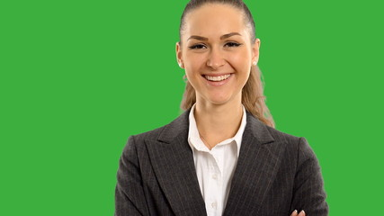 Young beautiful business woman looking at the screen smiling