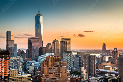 Lower Manhattan skyline at sunset Poster