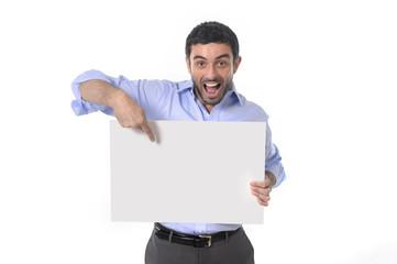 happy handsome business man pointing blank billboard