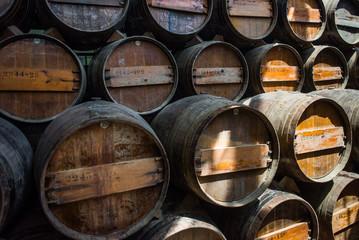 Wine barrels stacked in the cellar of the Quinta da Bacalhoa win