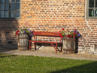 Bench between flowers in barrels
