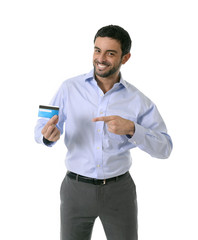 happy attractive smart casual businessman showing credit card