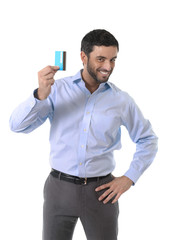 happy attractive casual businessman showing credit card