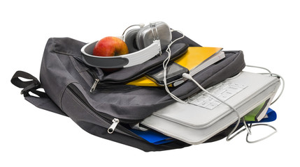 School backpack with school supplies and a tablet with headphone