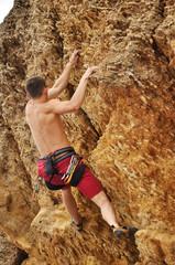 climber climbing on rock