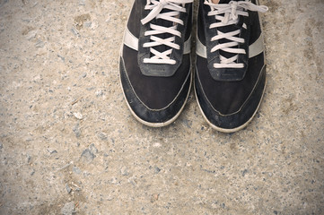 Men's sport shoes on a concrete floor