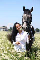 Beautiful caucasian young woman and horse portrait