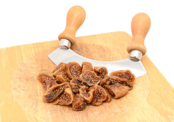 Chopped soft dried figs with a rocking knife