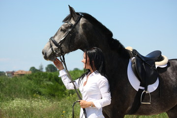 Beautiful caucasian woman and gray horse portrait