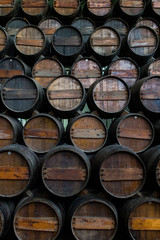Wine barrels stacked in the cellar of the Quinta da Bacalhoa
