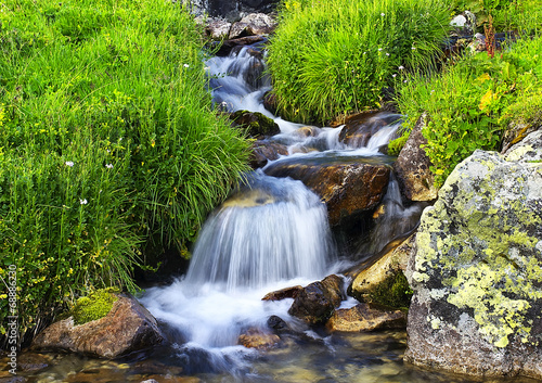 River among grass and stones. Beautiful natural landscape - 68886230