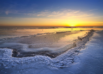 Sunset in the ice land. Beautiful winter landscape