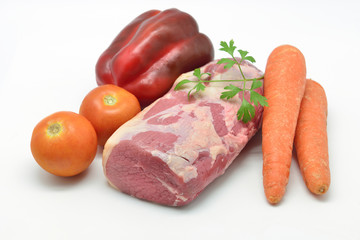 Bottom round roast raw with vegetables to prepare a recipe