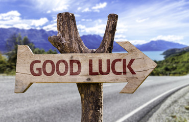 Good Luck wooden sign with a street background