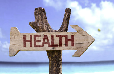 Health sign with a beach on background