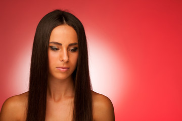 portrait of Beautiful hispanic woman in ftont of red background
