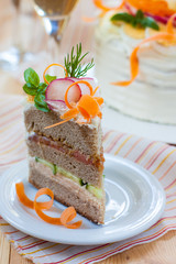 snack cake of black bread with smoked fish and vegetables