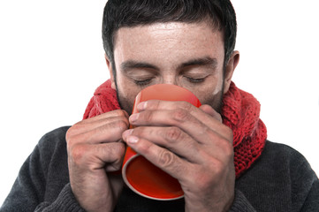 attractive man drinking cup of coffee in cold winter