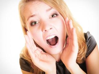 woman blonde buisnesswoman shouting on white