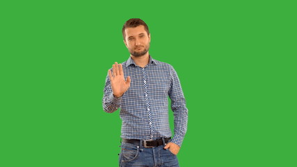 Young guy showing ban on a green background with alpha channel