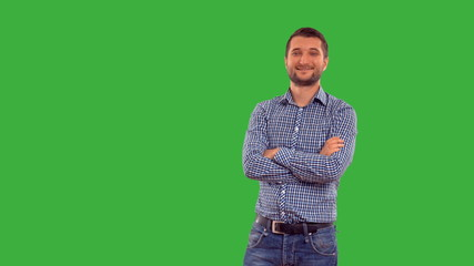 Young guy showing copy space on a green background with alpha
