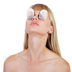 Beautiful woman tea bag therapy for tired puffy eyes