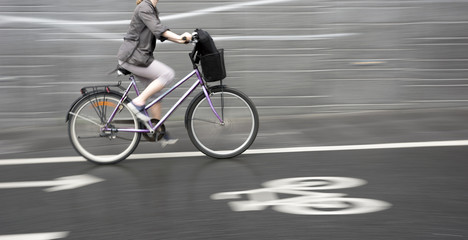 cyclist on purple bike