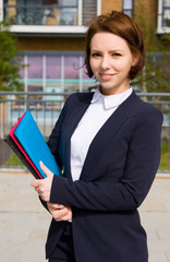 young business woman holding folders.