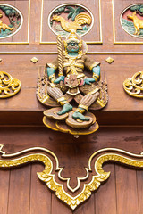 Thai giant Wood Carving on teak chapel