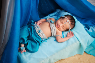 Smiling Newborn Baby Girl Wearing a Belly Dance Costume