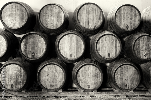 Leinwanddruck Bild Whisky or wine barrels in black and white