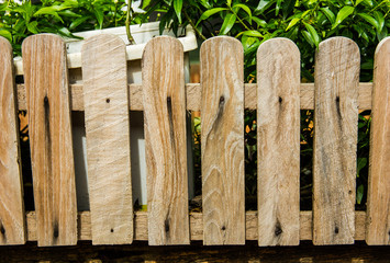 Picket fence with traditional wooden