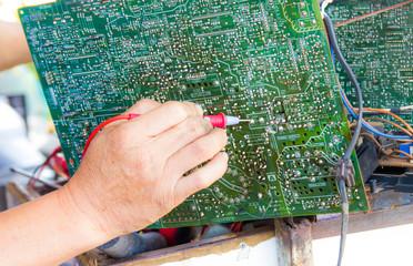 Photo of Repairman testing tv circuit