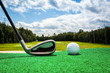 Close-up of a golf ball and a golf iron on a driving range