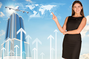 Businesswoman pointing her finger in direction