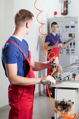 Factory workers during dangerous machine repair
