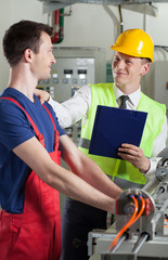 Controller talking with factory worker