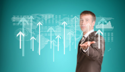 Businessman with graphs and arrows