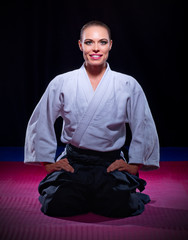 Smiling woman aikido fighter