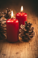 Christmas candles with pine cones